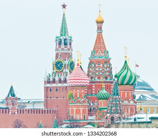 Spasskaya Tower of Moscow Kremlin and the Cathedral of Vasily the Blessed (Saint Basil's Cathedral) on Red Square. Winter day. Moscow. Russia