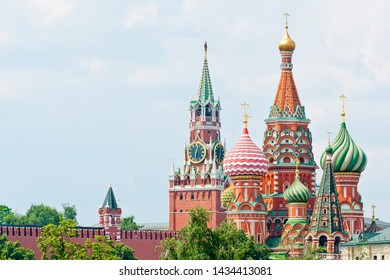 Spasskaya Tower of Moscow Kremlin and the Cathedral of Vasily the Blessed (Saint Basil's Cathedral) on Red Square. Summer sunny day. Moscow. Russia
