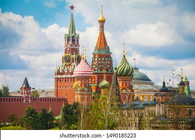 Spasskaya Tower of Moscow Kremlin and the cupolas of Saint Basil's cathedral in Moscow
