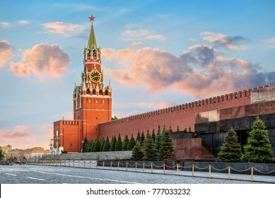 The Spasskaya Tower of the Moscow Kremlin on Red Square, illuminated by the rays of the setting sun of summer