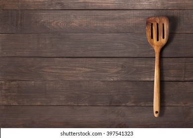 Spatula on the wooden background for you text.
