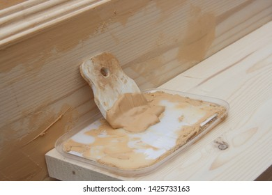 Spatula and putty for puttying wooden pine blanks for the manufacture of the shelf