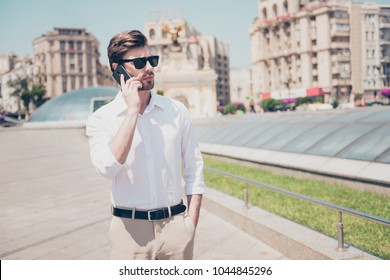 Speak talk tell communication organize people concept. Portrait of handsome serious attractive busy smart rich luxurious wearing drecc-code sharp dressed freelancer talking on phone