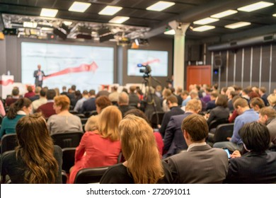 Speaker at Business Conference and Presentation. Audience in the conference hall. Business and Entrepreneurship.