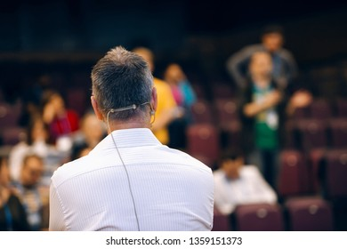 Speaker at business conference and presentation is listening question