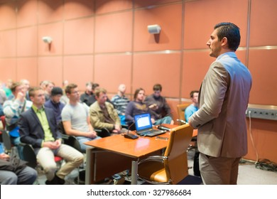 Speaker at Business Conference with Public Presentations. Audience at the conference hall. Business and Entrepreneurship concept. Background blur. Shallow depth of field.