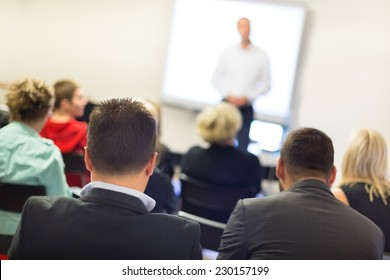 Speaker at business workshop and presentation. Audience at the conference room.