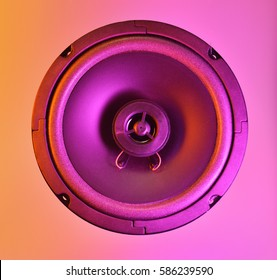 speaker in colored light, bright colors, colorful background.