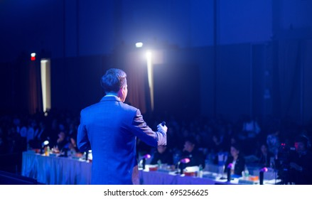 Speaker giving a talk on corporate Business Conference hall or seminar room background. meeting, event, business, presentation, exhibition.