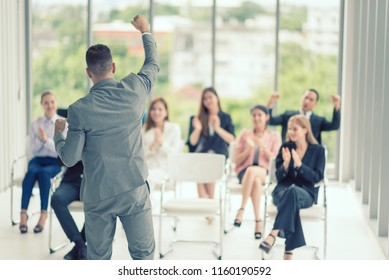 Speaker Seminar event training and Motivation Raising Hands for Business People and Coaching Teamwork. Achieve Business Excellence Celebrate corporation people. The Success Business People.