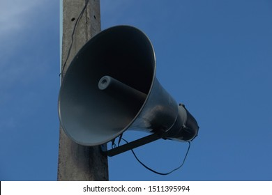 speaker setting on electric pole with bluesky background
