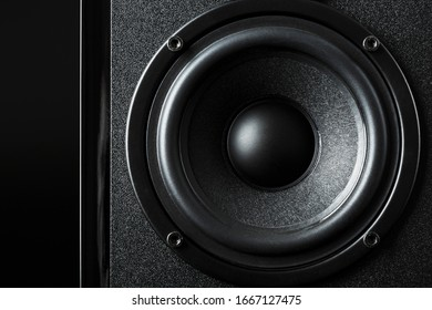 Speaker system speakers in close-up on a black background.