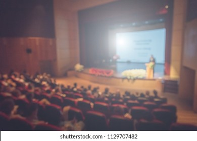 The Speaker Talking About Business Conference. Audience at the conference hall. Business and Entrepreneurship event.
