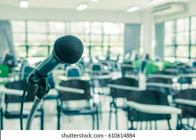Speaker's microphone in empty conference seminar meeting room, no people