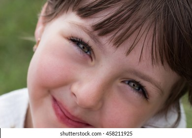 Speaking and smiling eyes of a child