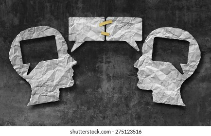 Speaking together social media concept as two crumpled pieces of paper shaped as a human head with talk bubble icons taped as a communication symbol for business  and compromise agreement.
