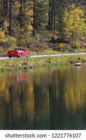 SPEARFISH, SOUTH DAKOTA, September 26, 2018 : A car drives in a river landscape of Spearfish Canyon.