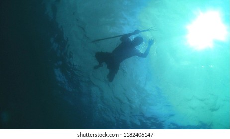 spearfishing in the blue sea water