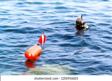 spearfishing hunter  man in underwater fishing sport , focus in buoy