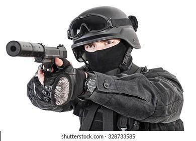 Spec ops police officer SWAT in black uniform with pistol studio