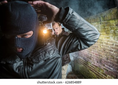 Special Agent arrests Criminal, pointing a gun and flashlight on him and orders him to put his hands up
