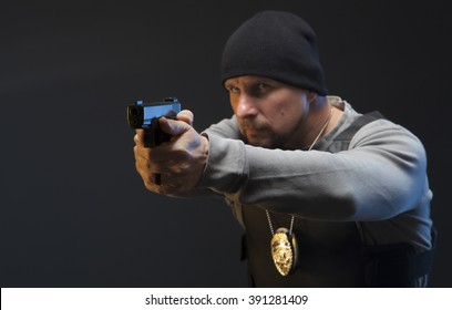 Special agent with a badge aiming at a suspect. Law enforcement officer with a gun.