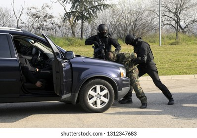 Special anti terrorist police unit arrest assaulter on a vehicle transporting vip person
