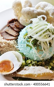 Special Asian style blue rice served with crackers, sliced beef, salted egg and other vegetables