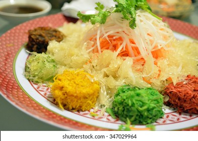 A special dish during Chinese New Year called Yusheng or Yee Sang