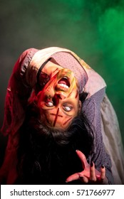 Special effects makeup and theatrical lighting bring this possessed girl character to life