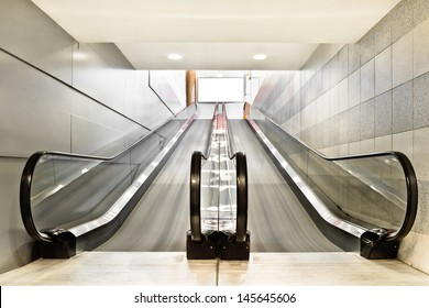 Special escalator in modern mall for people with supermarket carts and disabled people