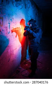 Special forces/ anti-terrorist police unit/private military contractor during night CQB hostage rescue raid/operation/mission (red and blue light for underline the atmosphere)