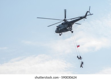 Special Forces commandos during operation with helicopter