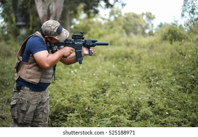 The special forces man aims rifle gun in forest, Military, war, conflict, soldiers man hold Machine gun , SEAL, special forces, police,
