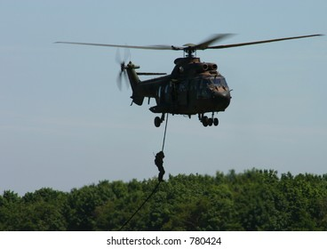 Special forces repelling down helicopter