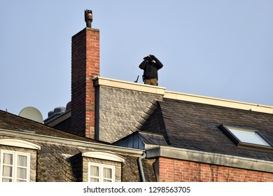 Special forces sniper securing a perimeter from a rooftop