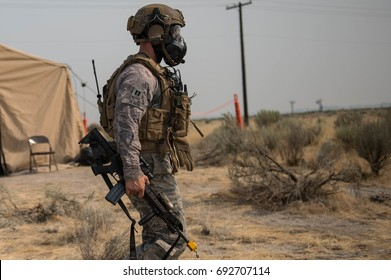 Special forces soldier with a gas mask and assault rifle