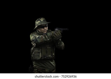 Special forces soldier with gun,Low-key lighting.