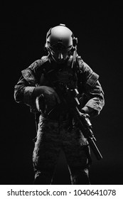 Special forces soldier with rifle on dark background. army, military and people concept