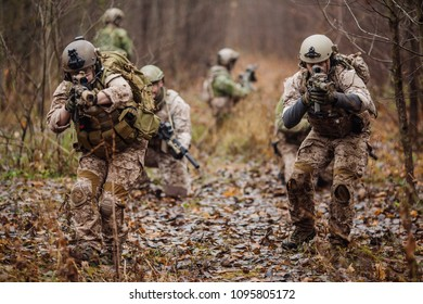Special forces soldiers with rifle. Military man on the background of nature.
