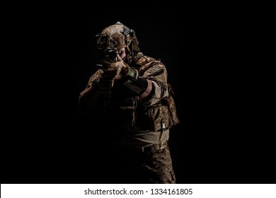 Special forces United States soldier or private military contractor holding rifle. Image on a black background. war, army and people concept