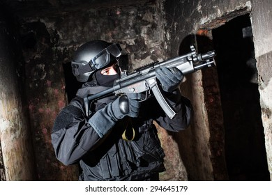 Special forces/anti-terrorist unit policeman or contractor during night CQB mission/operation (color toned image, very harsh lighting is used on this shot to underline the atmosphere of night mission)