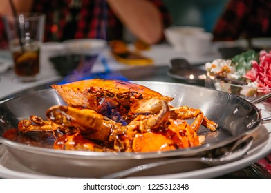 Special fried crab with chili sauce, Famous Singaporean recipe serving in restaurant.