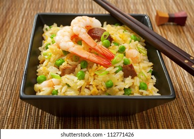 Special fried rice, or Yangchow fried rice, favourite Chinese food where barbecue pork, shrimp or prawn, onions and peas are added to fried rice cooked with egg.