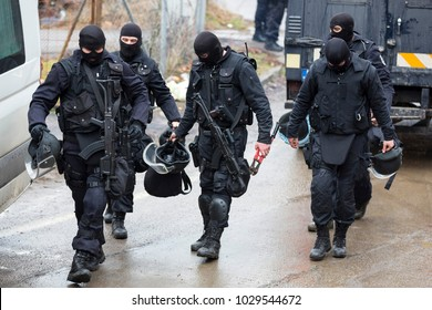 Special law enforcement unit. Special police force units in uniforms, bulletproof vests, firearms and guns. Masked police officers. Special Assault Team during mission. Sofia, Bulgaria - 4 Jan. 2018.