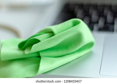 Special microfiber to wipe the monitor from dust. Microfiber for cleaning lenses and glasses. Green microfiber cloth for the care of the display.