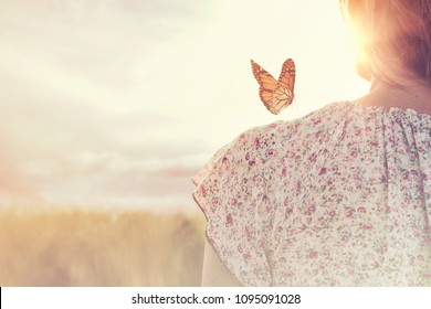special moment of meeting between a butterfly and a girl in the middle of nature