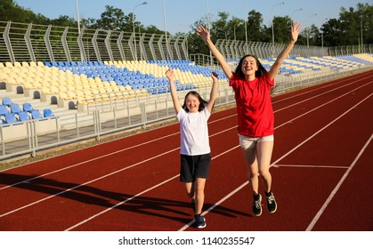 Special need girl have fun on the stadium