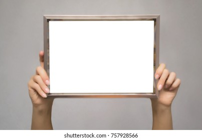 Special offer. Female hands holding empty blank photo frame above a head. Grateful letter. Gratitude concept. Thanks letter.