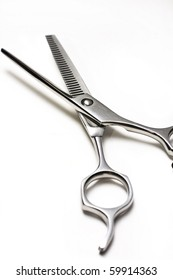 Special scissors for work of hairdresser on white